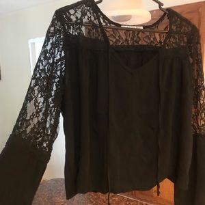 Very Cute Lace top size xl fits like a large